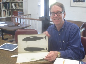 The author with Osborne's drawing of two right whales.  Courtesy of Martha's Vineyard Museum