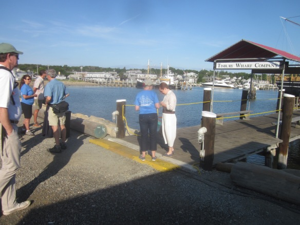 Vanessa showing details of outfit to Lesley on shore at Vineyard Haven